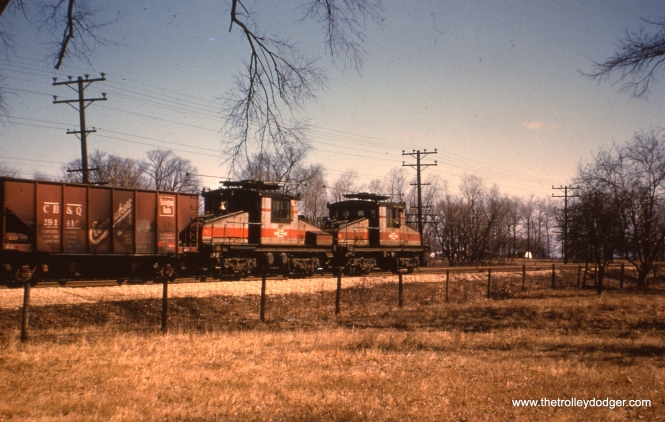 "#32 - WS: Nice going-away shot of a freight (locos #2001-2002). Location unknown. Jerry P. Hund says, ""I belelieve #32 was taken in Bellwood, just east of Bellwood Ave. We can also see some freight cars on the IHB track that came down the trestle from the mainline. All tracks would run parallel to the CGW mainline. This view is looking northeast."""