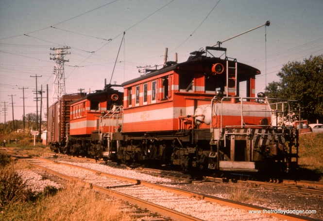 "#33 - Here we have a real difference of opinion: WS: Locos #3003-3004 switching in Aurora (just east of CB&Q xing). View looks N/E. AK: Freight train on Cook County Branch around Harrison St. Bill Shapotkin writes, ""This picture appears on Page 157 of SUNSET LINES (Vol 1), by Larry Plachno. The caption reads (in part): ""Here, locomotives 4006-4005 are switching the CB&Q interchange on the north side of Aurora,"" which, per the map on Pg 92 of said book, puts the location as being at Aurora Ave."""