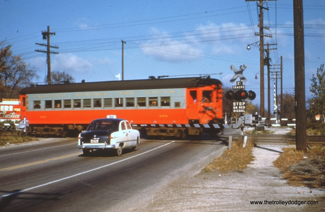#43 - EM: CAE 454 (St. Louis, 1945), eastbound, crosses 1st Av, Maywood. Will it turn back at Des Plaines AV? It depends on when the picture was taken relative to September, 1953. Notice the newer style crossing gates in contrast to the old gates is picture #9. WS: An E/B St Louis car (460?) in Maywood — believe it is s/o First Ave (note CGW xing in background). View looks north. Dan Hagstrom adds,