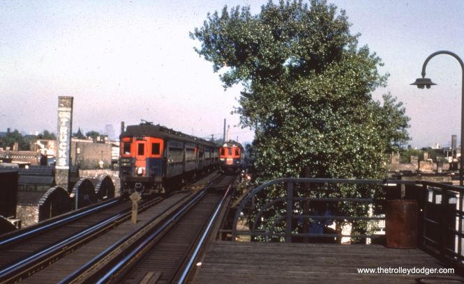 "#55 - JN: CA&E trains passing at Western Ave. on Garfield ""L"" EM: CAE 408 (Pullman, 1923) approaches Western Av station. Looking East."