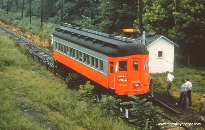 #61 - JN: Glenwood Park on Batavia branch (by old powerhouse). EM: CAE 406, probably on a fan trip, stops at Glenwood Park. Notice the nice new red paint job, meaning this picture is later than the picture in part 1 of 406 still painted blue.
