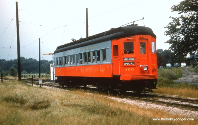 #69 - JN: Car under very short stretch of wire at State Rd. This was to help a car over the gap after it stopped at station westbound. EM: CAE 406 (Pullman, 1923) painted red and grey, at the State Road flag stop.