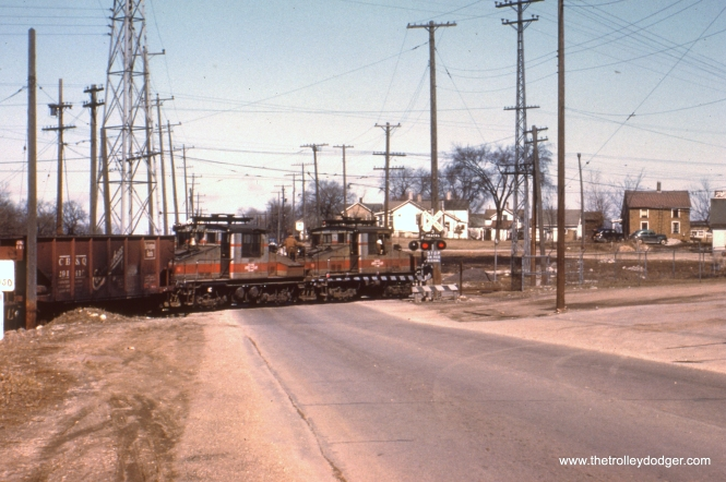 #70 - JN: Eastbound crossing Aurora Ave. near CB&Q interchange at Aurora EM: CAE 2001 and 2002 (General Electric, 1920 and 1922) pulling freight.