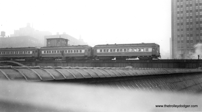 #2 - A three-car CA&E train heads west over Union Station, having just left Wells Street Terminal. (B. H. Nichols Photo)
