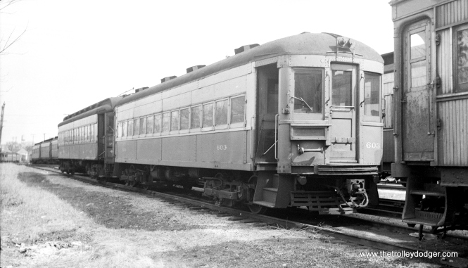 "#10 - CA&E 603 at Wheaton on April 2, 1957. Don's Rail Photos says, ""In 1937, the CA&E needed additional equipment. Much was available, but most of the cars suffered from extended lack of maintenance. Finally, 5 coaches were found on the Washington Baltimore & Annapolis which were just the ticket. 35 thru 39, built by Cincinnati Car in 1913, were purchased and remodeled for service as 600 thru 604. The ends were narrowed for service on the El. They had been motors, but came out as control trailers. Other modifications included drawbars, control, etc. A new paint scheme was devised. Blue and grey with red trim and tan roof was adopted from several selections. They entered service between July and October in 1937. """