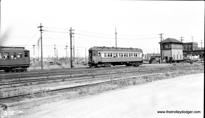 #12 - CA&E 402 at Laramie in March 1946, with CRT 2893 at left. 402 was built by Pullman in 1923 as one of the first steel cars on the CA&E.