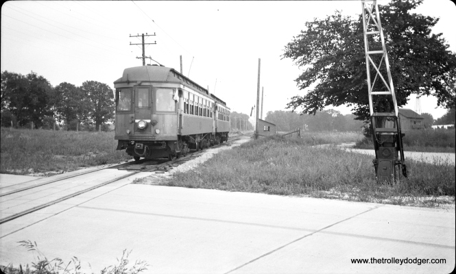 "#15 - Car 134 under a 90 foot stretch of trolley wire at State Road on the Batavia branch on August 31, 1941. According to Don's Rail Photos, ""134 was built by Jewett Car Co in 1907 as Chicago & Milwaukee Electric 134. It was rebuilt in 1914 retired in 1948."" When this picture was taken, this car was being leased by CA&E from the North Shore Line."