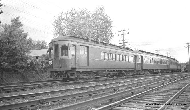 "#23 - CA&E 10. This car was wrecked on September 10, 1948 so this photo must predate that. Randy Hicks: ""the 10 is at the end of the train; the next car is the 320. I doubt this was a fantrip, as I've never seen five (or more) cars used for this purpose."""