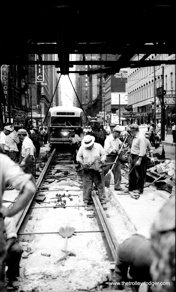 Here is another photo showing track work at Clark and Van Buren on July 17, 1954. We've added this to ten others we posted back in February. You can find that post at: https://thetrolleydodger.com/2015/02/12/track-work-clark-van-buren-1954/