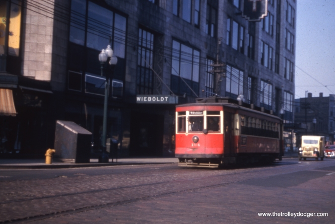 Eastbound CTA 194 passes Wieboldt's department store, which was located at about 850 W. 63rd Street, on May 1, 1952.