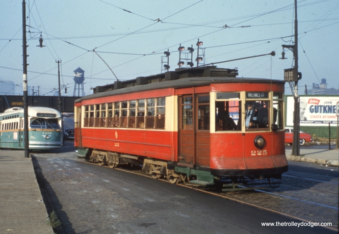 CTA streetcars 225 and 4406, in fantrip service, at Clark and 16th on October 21, 1956. By this time, streetcars were only being used on weekdays on the busy Clark-Wentworth line, so the fantrip cars did not really get in the way of the replacement bus service being offered by CTA.