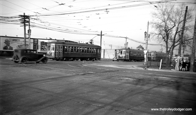 This would appear to be the corner of Harlem and Cermak. C&WT cars 160 and 157, going to the Brookfield Zoo and LaGrange, would have turned south here for a half mile before heading west on 26th Street. After streetcar service ended in 1948, and until the early 1970s, you could usually find a Good Humor man parked in what had been the trolley median just south of this location.