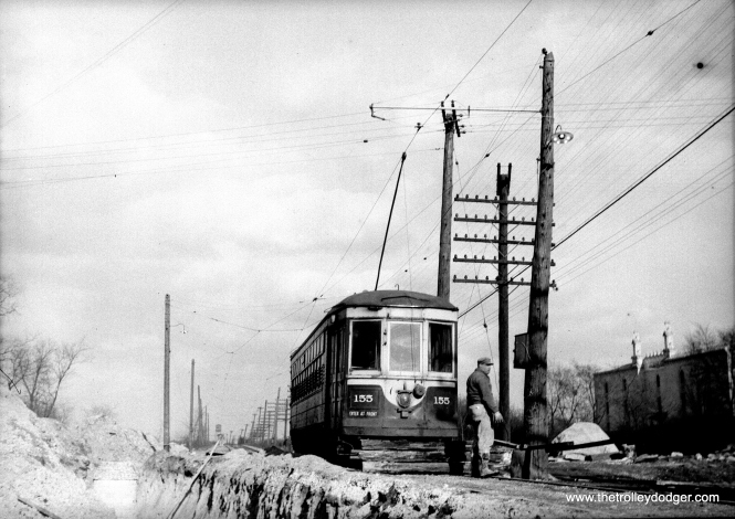 "C&WT 155 during winter. Bill Shapotkin says, ""I believe this photo is Hillgrove/LaGrange -- the short-lived terminal located east of LaGrange Rd after (sewer work(?)) cut the line back from Brainard Ave. View looks east."""