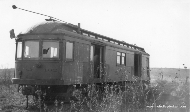Car 102 of the the Elgin Belvidere & Rockford sits forlornly in Marengo in this June 1937 photograph. By then, the line, which quit service on March 9, 1930, had been abandoned for more than seven years. Owner Bion J. Arnold kept these cars in storage in the futile hope that a buyer could be found. We can thank the unknown photographer who preserved this small slice of history.