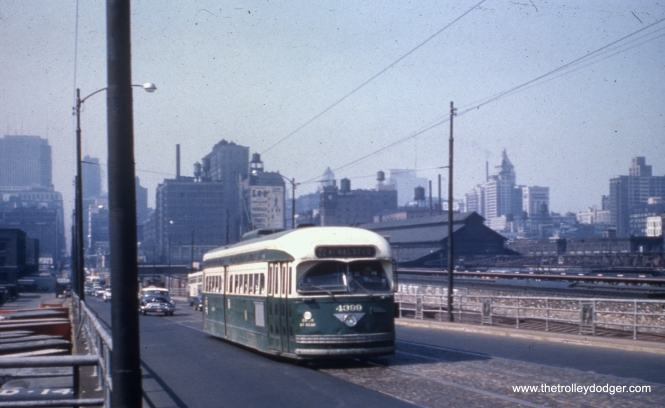 CTA 4399 heads south at Clark and Roosevelt on July 16, 1957.