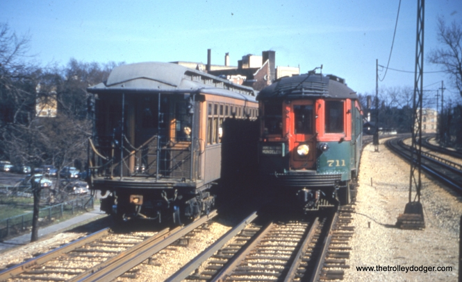 NSL 711 passing a CTA gate car at Jarvis looking south in the 1950s, headed for the Mundelein branch.