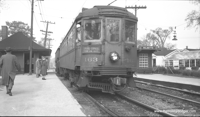 Car 163 heads up a southbound two-car train at the North Shore Line's Wilmette station at East Railroad and Greenleaf Avenues on the Shore Line Route on October 24, 1948. (Richard H. Young Photo, Super XX Film)