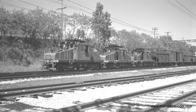 Electric locos 454, 452, and 453 head up a southbound freight train that will soon switch off from the Skokie Valley to the Mundelein branch at Lake Bluff in this June 3, 1960 scene. (Richard H. Young Photo)
