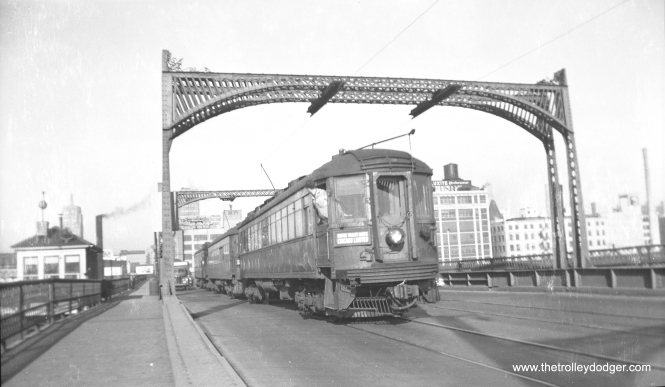 A southbound Chicago Limited, headed for the Skokie Valley Route, crosses the 6th Street bridge in Milwaukee. (Charles K. Willhoft Photo)