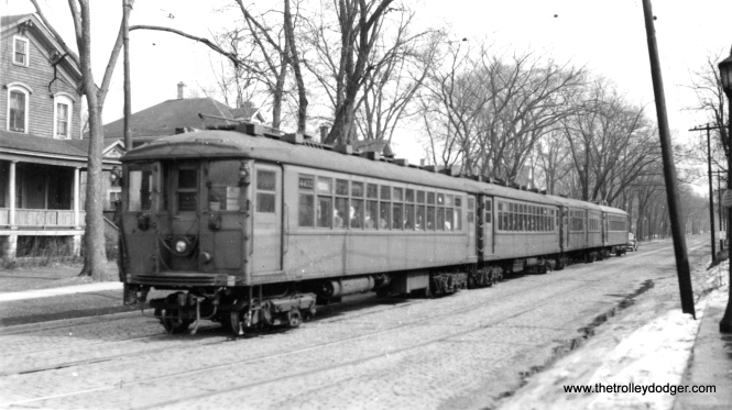 "Those 4000s sure got around in their day. Here is a rare shot of Chicago Rapid Transit Company ""L"" car 4432 heading up a train in North Shore Line street running territory on Greenleaf Avenue in Wilmette. It was probably pressed into service hauling the military during World War II."