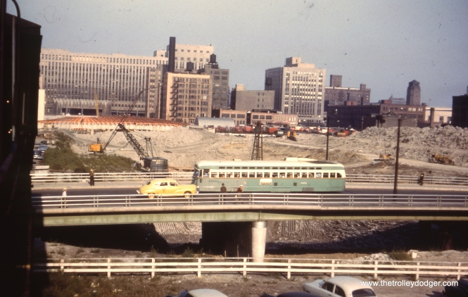 CTA 4282, a Pullman, passes the Congress expressway construction site on Halsted in 1952. In general, bridges were built first, and areas around them dug out afterwards. This section of highway opened in late 1955, by which time the streetcars had been replaced by buses.