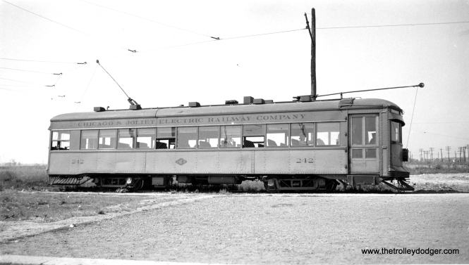 "Chicago and Joliet Electric Railway #242, shown at the Archer and Cicero station in Chicago in September 1933. (Robert V. Mehlenbeck Photo) Mehlenbeck was member #11 of Central Electric Railfans' Association. According to Don's Rail Photos, ""242 was built by Cummings Car & Coach Co in 1927."" Service on this line, which connected to the Chicago, Ottawa & Peoria, was abandoned on November 16, 1933."