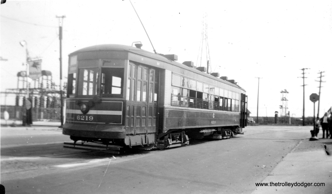 "Chicago Surface Lines #3219, a one-man car built by CSL, as it looked on September 8, 1940. This car had formerly been used on the line to East Chicago, Indiana, which was abandoned three months before this picture was taken. This is also known as a ""maximum traction"" car because of its trucks. The white stripe on the end indicated it was a one-man car. Bob Lalich says this is ""106th and Indianapolis. The car is eastbound."""