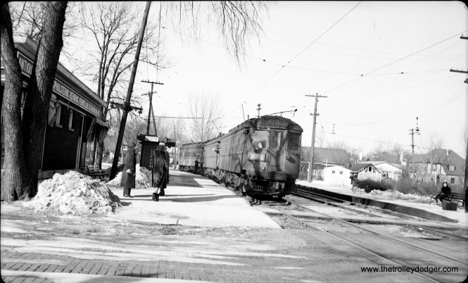 CNS&M 168 heads up a three-car Chicago Local on the Shore Line Route, stopping at Linden Avenue in Wilmette. The date is February 11, 1939.