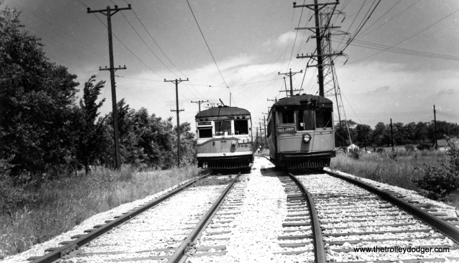 "Speedrail cars 300 and 65, both signed for Hales Corners. According to Don's Rail Photos, ""300 was built by St Louis Car in 1924. #1308. In 1936 it was sold to Cleveland Interurban RR as 300. CI became Shaker Heights Rapid Transit in 1944. It was sold to Milwaukee Rapid Transit & Speedrail in May 1950 as 300. It was scrapped in 1952."" Car 65 at right is a ""curved side"" car built by the Cincinnati Car Company. It also came by way of Shaker Heights."