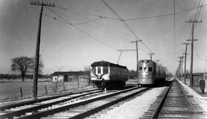 "Milwaukee Electric car 1121 and an Electroliner near Racine on the 1949 North Shore Line fantrip. Don's Rail Photos adds, ""1121 was built by Kuhlman Car in February 1909, #405. It was rebuilt in 1927. It was equipped with GE-207B motors to allow it to pull trailers. In 1949 it was found to have the best wheels, and thus it was selected for the fantrip on the North Shore Line to Green Bay Junction near Rondout. It was also used as a freight motor after the last regular freight motor was wrecked in 1950."""