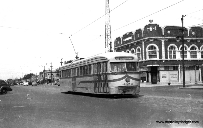 Prewar PCC 4050, in experimental colors, heads east about a block from the turnaround loop at Madison and Austin on route 20. This photo was taken circa 1945-46 and you can just barely make out a Chicago & West Towns streetcar further back. Austin Boulevard is the boundary between Chicago and Oak Park. (Railway Negative Exchange Photo)