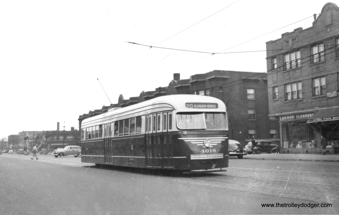 CSL 4010, in 1945-46 experimental paint, heads east at 5322 West Madison. The Surface Lines tried out various color schemes before deciding on the iconic combination of Mercury Green, Croydon Cream, and Swamp Holly Orange for the postwar cars. Interestingly, none of the six cars that were repainted had the exact color scheme that was ultimately selected. (Railway Negative Exchange Photo)