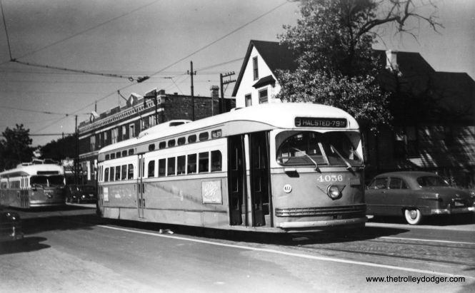 "St. Louis-built PCC 4056. At irst I thought this was 81st and Halsted, but as Mike Engelberg points out, ""Notice there is only a single track on this street. Therefore it is not at 81st and Halsted. Methinks this is on Emerald south of 79th, particularly because the roll sign is for Halsted route 8, not Clark-Wentworth route 22. Also compare the two-story building here versus the two-story building in photos of 81st and Halsted. They are not the same."" That appears to be a 1949 Ford at right, but this picture was taken later, due to the presence of advertising frames on the side of the streetcar. (Railway Negative Exchange Photo)"