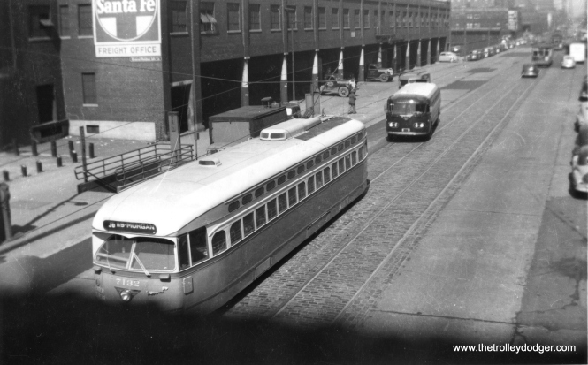 PCC 7132 going south on route 36 - Broadway-State, having just passed the Santa Fe Freight Office. Just to the left of the streetcar, you can see an entrance to the State Street subway, which opened in 1943. That looks like a Continental Air Transport bus behind the PCC. (Railway Negative Exchange Photo)
