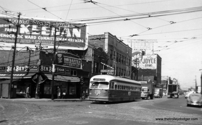 PCC 4396 southbound at Clark and Devon. The election poster would indicate a date of 1955 for this picture, since, as Jeff Wien notes, this car has already been repainted in Everglade Green, which the CTA started doing around July 1952. (Railway Negative Exchange Photo)