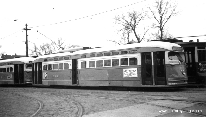 CTA 7122, signed for route 49 - Western, at Ashland and 71st. The election ad on the side of the car and the lack of leaves on the trees would date this picture to the Fall of 1952. Sherwood Dixon (1896-1973) was the unsuccessful Democratic candidate for governor that year, losing to State Treasurer William G. Stratton, who served two terms. (Railway Negative Exchange Photo)
