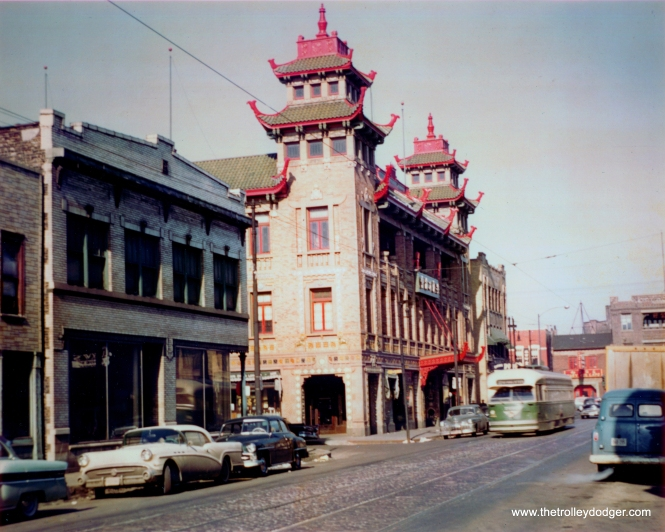 A PCC passes the historic Pui Tak Center Building in Chinatown while heading south on route 22. The building is at 2216 South Wentworth Avenue, just south of Cermak Road. The car at left is a 1957 Buick. There is a similar (better, actually) picture taken at this location by Charles L. Tauscher on page 211 of CERA Bulletin 146.