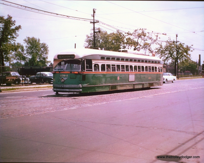CTA 4384 is apparently southbound on Western in the mid-1950s. and signed to go only as far as 69th, making this a pull-in.