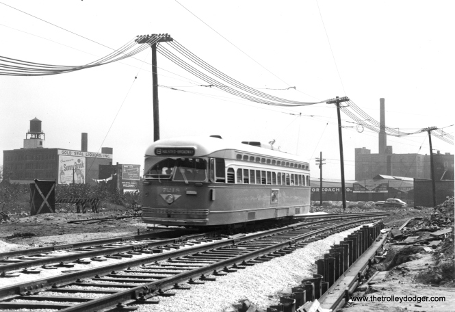 CTA 7218 is heading north on shoofly trackage at Hasted and Congress circa 1952, while the bridge that would take Halsted over the Congress (later Eisenhower) expressway was being built. There was a photo taken near this location, facing west, in our first post of PCC photos from the Trapp Collection. (Originally from the collections of Joe L. Diaz)
