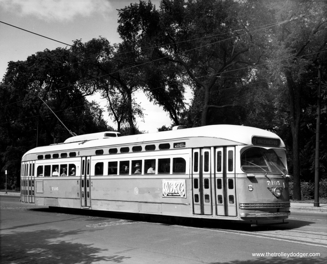 This photo of PCC 7195 was probably taken by the CTA and the car is heading south on Clark Street opposite Lincoln Park. The ad is for TV station WBKB, which was originally called W9XBK and was Chicago's first television station starting in 1940. The B and K in WBKB stood for the owners, the Balaban and Katz chain of movie palaces. It was eventually a CBS affiliate on channel 4 and became WBBM-TV channel 2 when the FCC reassigned frequencies. There was a second WBKB then on channel 7, now WLS-TV, and there is yet a third WBKB nowadays in Alpena, Michigan, a CBS affiliate that airs on channel 11.