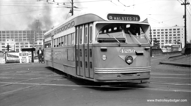 Pullman PCC 4259 is turning from diversion trackage on Chicago Avenue onto southbound Halsted on July 30, 1952. This would be due to the bridge carrying Halsted over the Chicago River being out of service. The landmark Montgomery Wards complex is at rear. (Thomas H. Desnoyers Photo, Krambles-Peterson Archive)