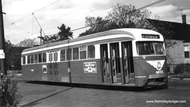 "CTA 4022, with some obvious front end damage, eastbound on the 63rd Street line. There is an ad on the side of the car promoting Hawthorne Race Course, which opened in 1891. One of our readers writes, ""I believe that this car is laying over on the wye at 63rd and Central Park waiting to head east to Stony Island. The car was still two man at the time, but being in Everglade Green, I would date it as mid 1952 before the cars were sent to Cottage Grove after being converted to one-man operation."" (R. Alexander Photo, Krambles-Peterson Archive)"