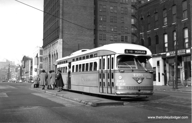 Riders are exiting from the middle door in this view of 7101 at State and Roosevelt taken on October 24, 1948. These concrete platforms were called Safety Islands and once dotted the city.
