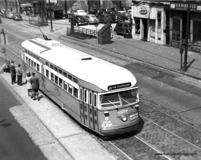 "Riders are about to board via the rear on postwar PCC 4257, ""Another New CTA Streetcar,"" southbound at State and Roosevelt in 1948."
