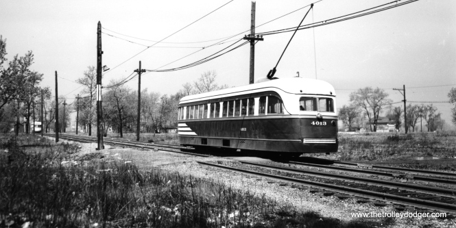 Prewar PCC 4013 on private right-of-way near the western end of the 63rd Street route, between Central and Narragansett. I think the car is heading west. This is now a completely built up residential area today. Most likely we are early in the CTA era. (Joe L. Diaz Photo)