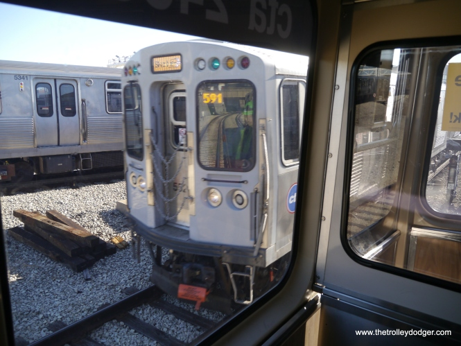 Two Yellow Line trains pass each other. Besides the 2400s, I saw 5519-5520 and 5521-5522 running.