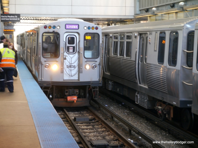 One of the last AM Purple Line Express trains enters the station. It will continue to Linden over the Evanston branch.