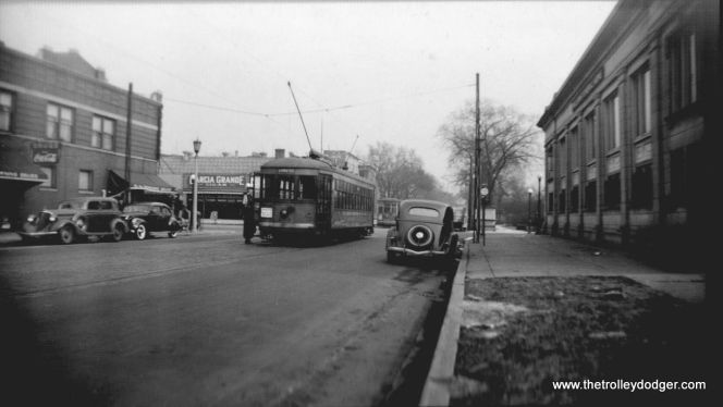 C&WT 103 at the east end of the Lake Street line at Austin Boulevard in 1938, waiting to meet a Chicago Surface Lines car on the other side of the street.