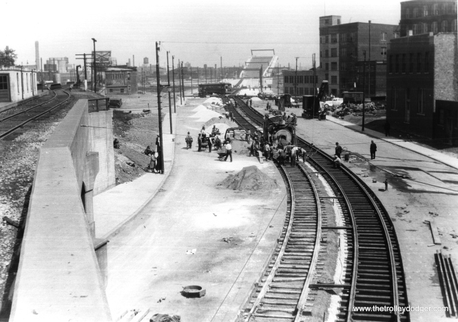 "The extension of the Ashland streetcar across a new bridge over the Chicago River in 1936 was one of the last such line extensions by CSL. We previously posted a photo of the parade celebrating this line extension here: https://thetrolleydodger.com/2015/02/28/chicago-streetcars-in-black-and-white-part-2/ (Edward Frank, Jr. Photo) Bill Shapotkin adds, ""This pic was taken from the Clybourn C&NW passenger station (the platform for the S/B (timetable E/B) North Line (then Milwaukee Division) is visible at left) looking N/B on Ashland. Great pic!"""