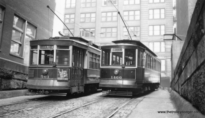 CSL 561 and 1466 at the entrance to the Van Buren streetcar tunnel. 1466 is signed as a demonstration car, i.e. training. You can see another view of this tunnel, taken from the opposite direction, in a previous post: https://thetrolleydodger.com/2015/02/28/chicago-streetcars-in-black-and-white-part-2/ (Joe L. Diaz Photo)